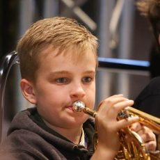 Young boy playing trumpet