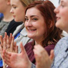 Girls applauding
