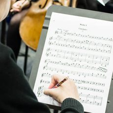 Image of student marking a musical score