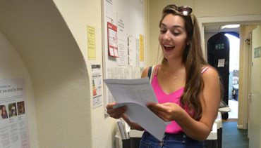 Girl receiving exam results and beaming