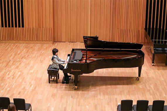 Leo Bailey Yang playing the piano