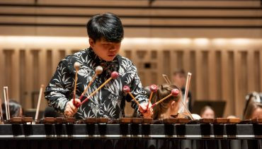Fang leads Chetham's Symphony Orchestra on the marimba, February 2020, in The Stoller Hall